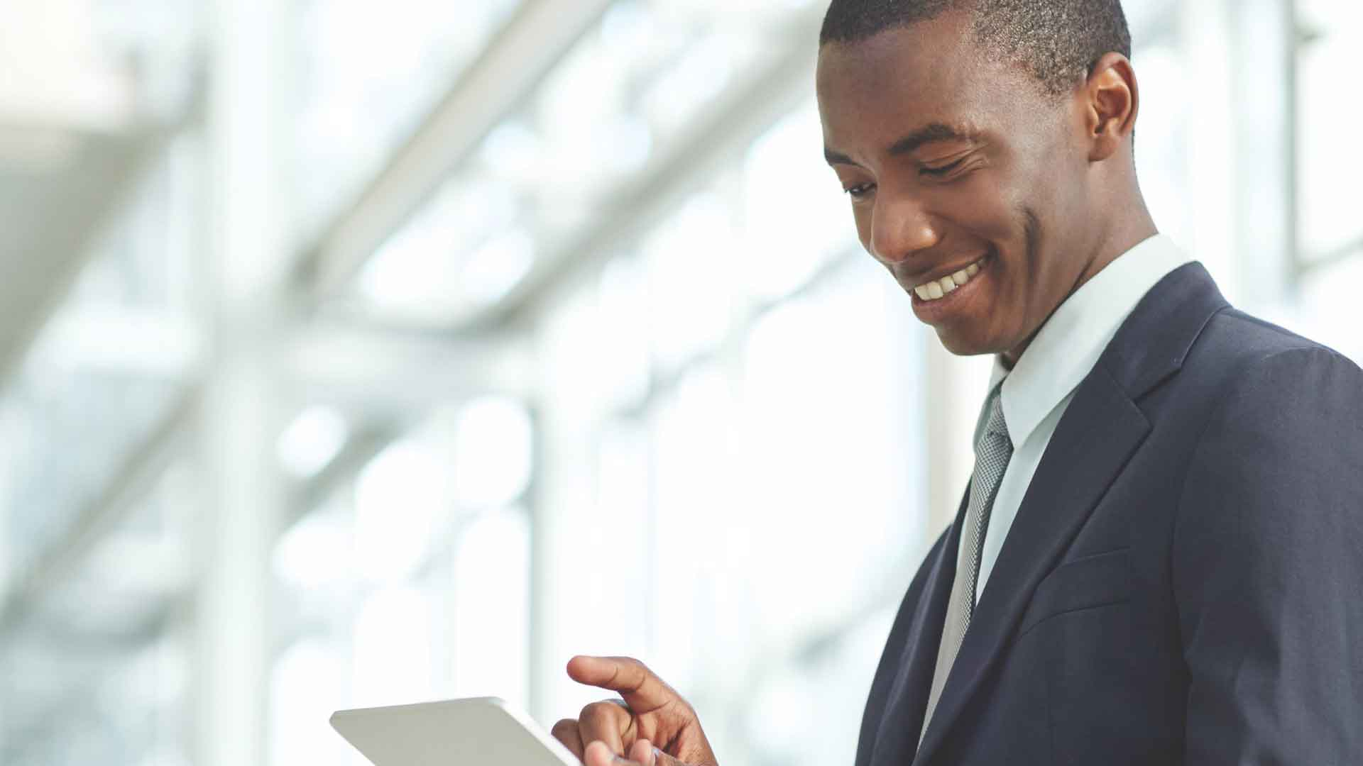 person-on-the-right-side-in-suite-and-tie-holding-tablet-cropped